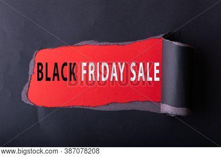 Black Torn Paper With  Des Scription Black Friday Day Sale On Red Background For Background. Black F