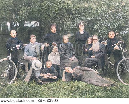 Painted Old Family Photo. Parents With Nine Children. Nostalgic Vintage Picture. In Children, Two Bi