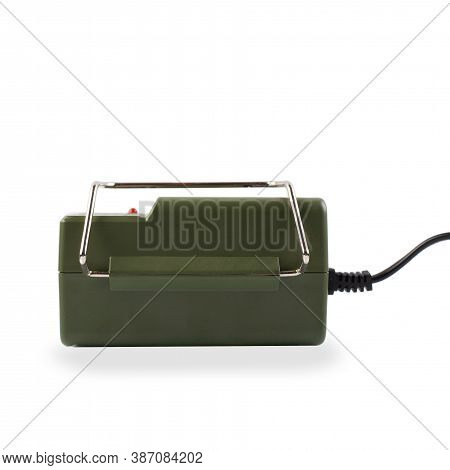 Ac Adapter Isolated On A White Background. Power Supply For Manual Drill Cutter.