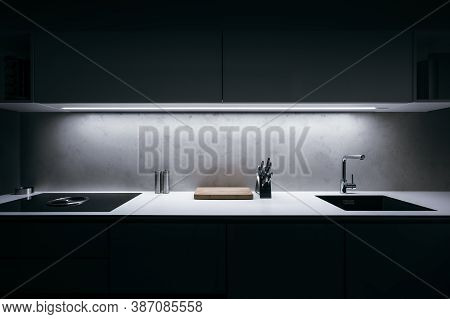 Modern Kitchen In Minimalist Design During Night With Led Light Strip And Premium Materials Such As