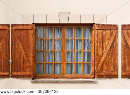 Typical Spanish Window With Open Wooden Shutters, Non Decorated With Fresh Flowers