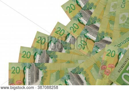 20 Canadian Dollars Bills Lies In Different Order Isolated On White. Local Banking Or Money Making C