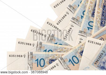 10 Tunisian Dinars Bills Lies In Different Order Isolated On White. Local Banking Or Money Making Co