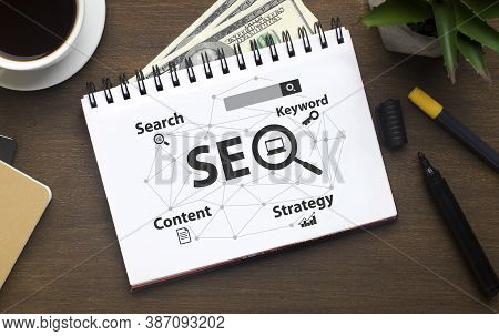 Seo Career. Opened Notebook With Seo-optimization Scheme Lying Over Brown Office Table Background. S