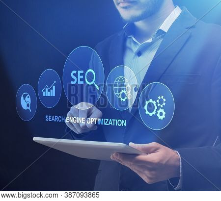 Search Engine Optimization. Businessman Using Digital Tablet Using Seo-optimization Tools Standing O