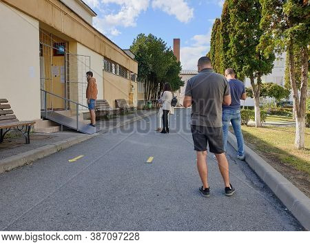 Cluj-napoca, Romania - September 27, 2020: Local Elections Day In Romania. People In Line At Local E