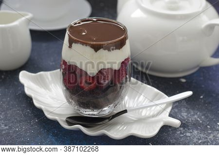 Trifle With Raspberry Cream And Chocolate Sauce