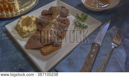 Hot Roast Beef Sandwich With Mashed Potatoes Covered With Brown Beef Gravy.