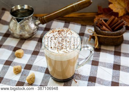 Pumpkin Spice Coffee With Whipped Cream, Seasonal Autumn Decoration. Cinnamon Sticks And Decorative