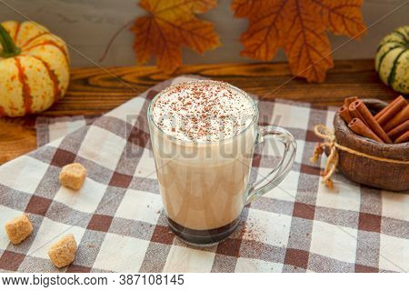 Pumpkin Coffee With Spices, Dried Leaves And Little Pumpkins, Warm Autumn Colors.