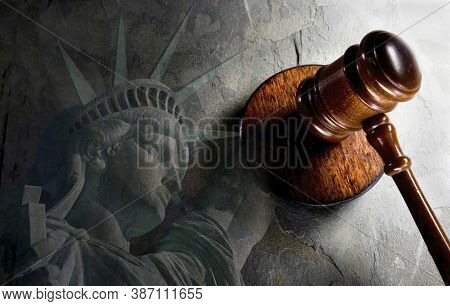 Justice And A  Wooden Gavel With Lady Liberty.