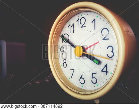 Alarm Clock - A Vintage Alarmclock In A Faded Background With Copy Space