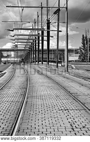 Tram Tracks And Electric Traction On The Viaduct In The City Of Poznan In Poland, Black And White