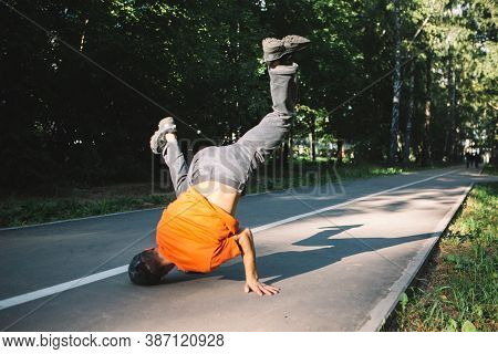 Cool Young Guy Dancing Breakdance On The Road In The Park In Summertime. Breakdancing School Poster