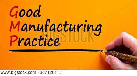 Hand Writing 'gmp, Good Manufacturing Practice', Isolated On Beautiful Orange Background. Business C