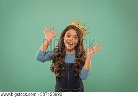 Expert Of Fun. Kid Wear Golden Crown Symbol Of Princess. Girl Cute Baby Wear Crown While Stand Blue