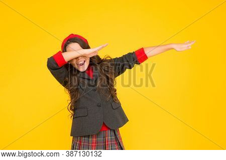 Childhood Fun. Happy Child Wear Uniform Yellow Background. Back To School. Childhood Care And Educat