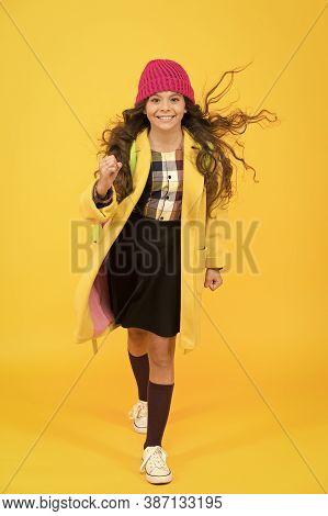 Stylish Schoolgirl Go Forward. Go To School. Happy Pupil Kid Yellow Wall. Back To School. Desire For