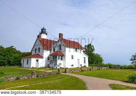 Point Iroquois Lighthouse. The Point Iroquois Lighthouse Is Located On The Coast Of Lake Superior An