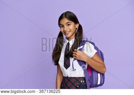 Happy Smiling Indian Preteen Girl, Latin Kid Schoolgirl With Ponytails Wears Uniform Holding Backpac