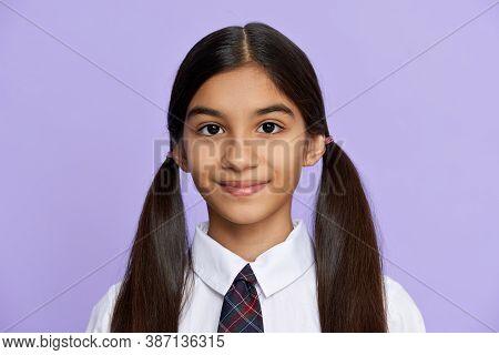 Cute Pretty Smiling Indian Hispanic Tween Kid Girl With Ponytails Wearing School Uniform Standing Is
