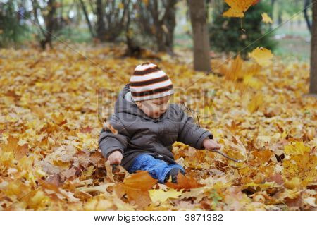 Happiness Child Playing In Forest