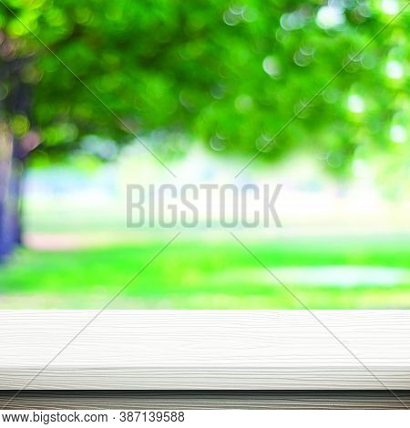 White Wood Table For Food, Product Display Over Blur Green Garden Background, Empty Wooden Shelf, De