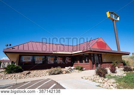 Colorado Springs, Colorado - September 14, 2020: Abandoned And Closed Dennys Restaurant On A Sunny D