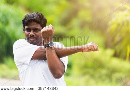 Close Up Asian Young Sport Runner Black Man Wear Watch He Body Warming Up Arms Muscles Before Runnin