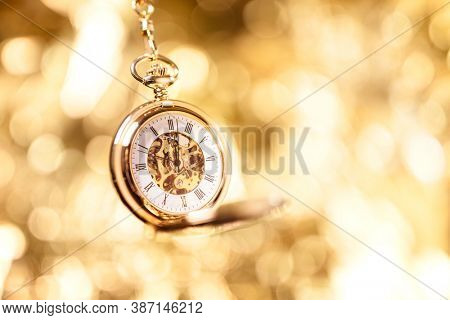 Gold pocket watch background with copy space
