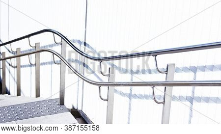 Undulating And Wavy Stair Railing Close To Train Station