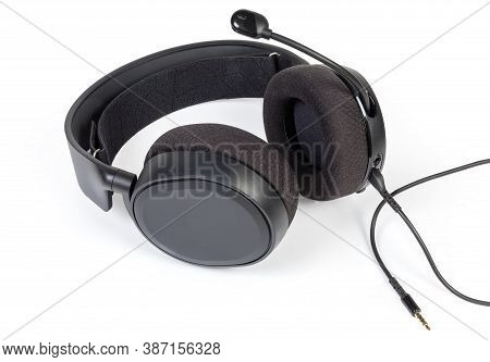 Black Wired High-fidelity Headset With Full Size Headphones And Connected Audio Cable On A White Bac