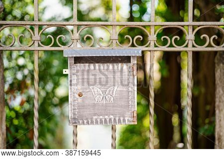 Close-up Of A Metal Mailbox With A Butterfly Pattern On The Gate, Shallow Depth Of Field.