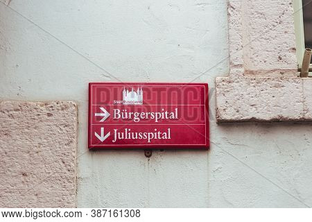Red Directional Sign On A Street In Wurzburg, Germany