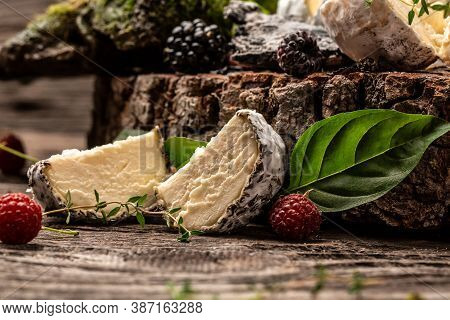Camembert Or Brie French Soft Cheese With Berry, Basil. Fresh Brie Cheese With White Mold. Banner, C