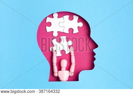 Help With Mental Illness Concept. Papercut Head With Jigsaw Puzzle Pieces Inside. Mental Health Prob