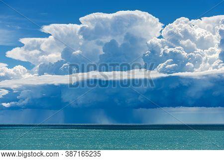 White Clouds In The Blue Sky. Cumulonimbus With Torrential Rain Over The Mediterranean Sea. Gulf Of