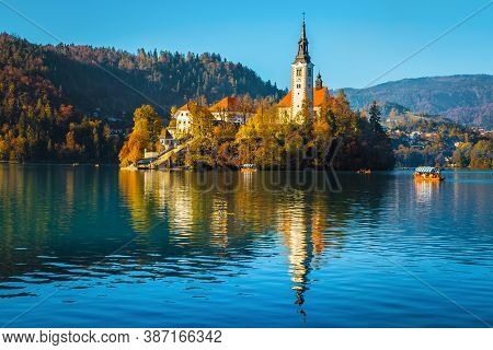 Popular Travel And Excursion Destination At Autumn. Amazing Lake Bled With Picturesque Pilgrimage Ch