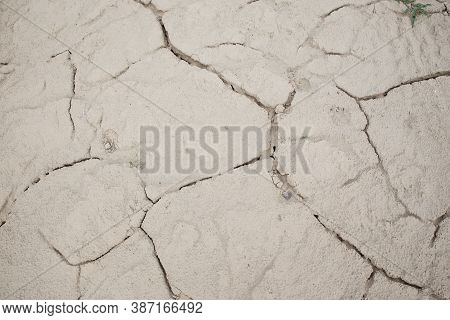 Cracked Earth Soil Ground Texture Background. Mosaic Pattern Of Dried Mud Clay Earth And Sand, Top V