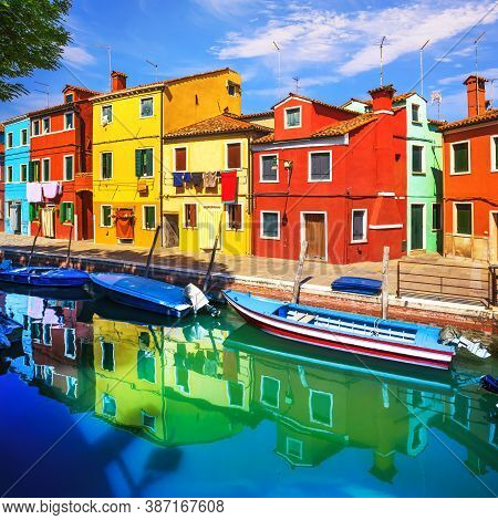 Burano Island Canal, Colorful Houses And Boats In The Venice Lagoon. Italy, Europe.
