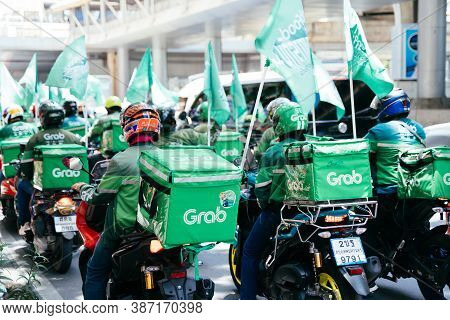 Bangkok, Thailand - August 24, 2020 : Group Of Grab Riders Riding A Motorbike Doing Their Services.