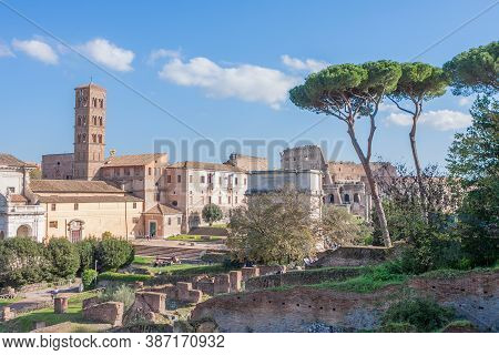 Roman Forum, Rome, Italy. View On Roman Forum And Colosseum On Sunny Day