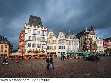 Trier, Germany - October 11, 2019: Colorful Gothic Houses Under Dramatic Sky. Old Market Square In T