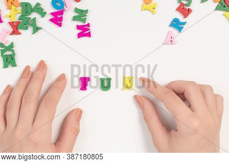 Female Hands Spread The Word Fun From Colored Letters