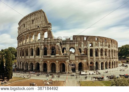 Colosseum with long exposure, the world known landmark and the symbol of Rome, Italy.