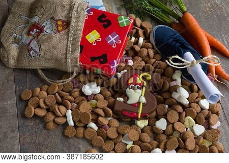 Dutch Candy Called Pepernoten Eaten During Sinterklaas Feast. Beside It Presents For The Kid And The
