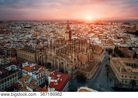 The Cathedral of Saint Mary of the See or Seville Cathedral at sunrise as the famous landmark in Seville, Spain.