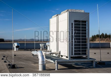 Air Vents On The Roof Of Building In Functional And Operational Condition. Around Are Seen Vent Pipe