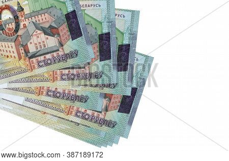 100 Belorussian Rubles Bills Lies In Small Bunch Or Pack Isolated On White. Mockup With Copy Space.