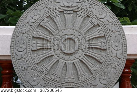 Stone Carving Of The Wheel Of The Dharma.